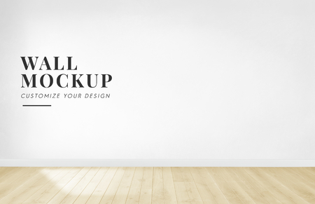 Empty room with a white wall mockup Stok Fotoğraf