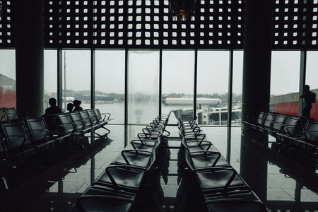 Rows of empty chairs in an airport