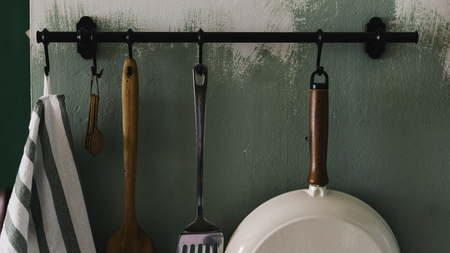 Kitchen tools hanged on the wall Stock fotó