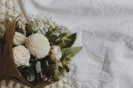 A bouquet of white dahlia and roses Фото со стока