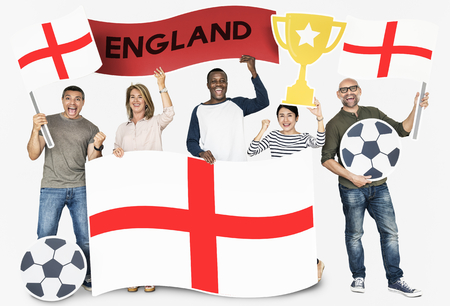 Diverse football fans holding the flag of England