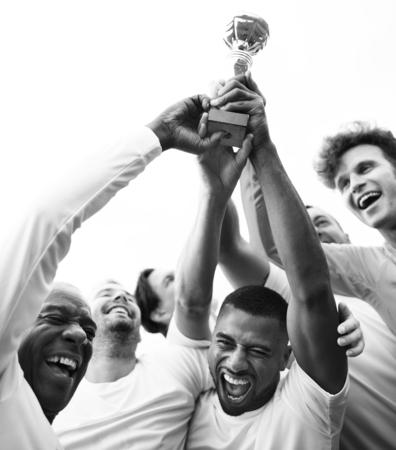 Soccer players team celebrating their victory 版權商用圖片