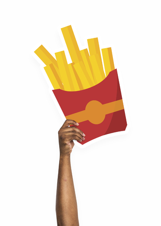 Hand holding a french fries cardboard prop