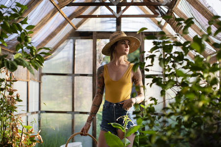 Beautiful woman in a greenhouse