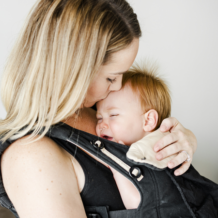 Mom with her baby in a carrier