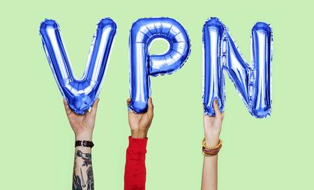 Hands holding VPN word in balloon letters 版權商用圖片