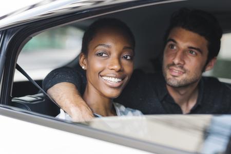 Happy couple transporting via a car Stock Photo
