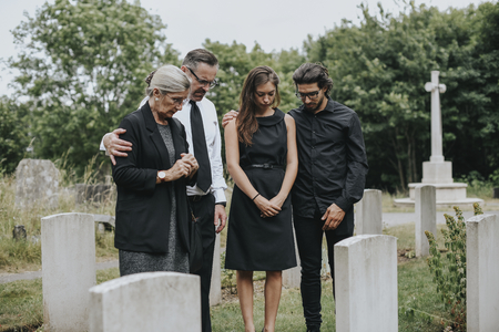 Family giving their last goodbyes at the cemetery