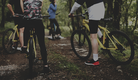 Friends cycling together in the countryside 免版税图像