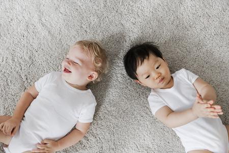 Babies lying on the floor Stock Photo
