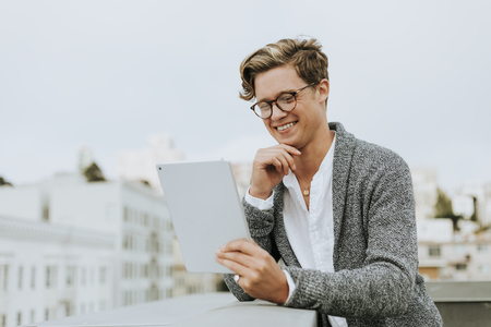 Man using a digital tablet at a rooftop in San Francisco Stock Photo