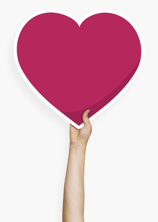 Hand holding a heart cardboard prop 스톡 콘텐츠 - 116719133