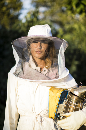 Beekeeper posing with the smoker Stock Photo