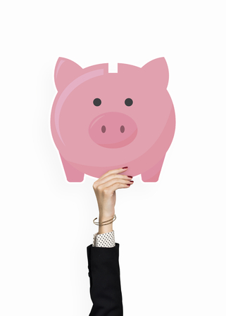 Hand holding a piggy bank clipart