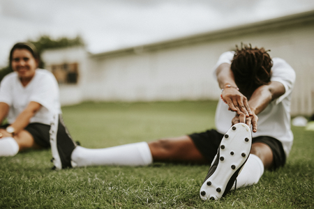 Female football player stretching before a match Stok Fotoğraf - 116690368