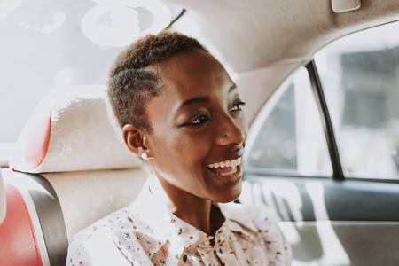 Cheerful woman in a car Stock Photo
