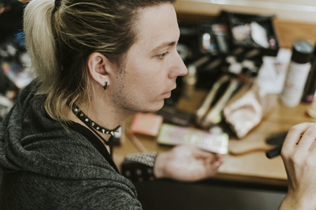 Male makeup artist at work Stock Photo