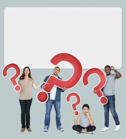 Diverse people holding question mark icons