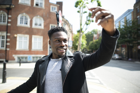 Handsome tourist taking a selfie