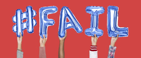 Hands holding #fail word in balloon letters