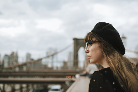 Woman on the Brooklyn Bridge, USA 写真素材