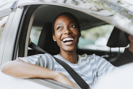 Cheerful woman in a car Фото со стока