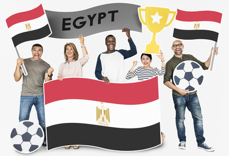 Diverse football fans holding the flag of Egypt 스톡 콘텐츠