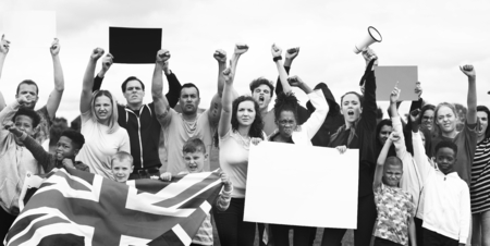 Mixed group of English people protesting