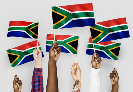 Hands waving flags of South Africa