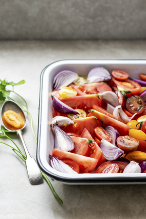 Mixed onions and tomatoes in a tray Stock Photo