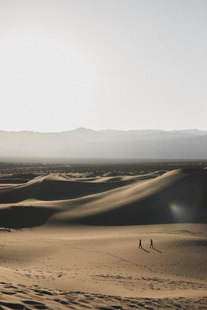 Couple walking in the Death Valley in California, United States Stock Photo