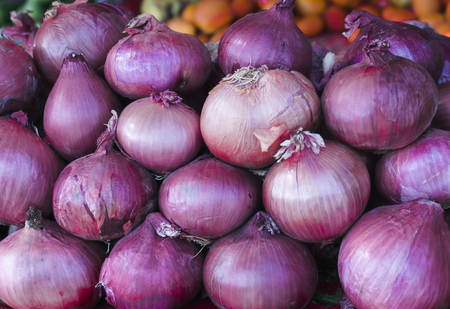Organic onions in farmers market closeup