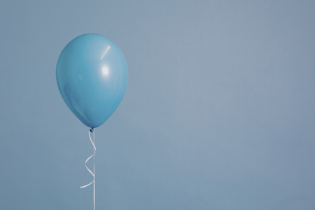 Blue single balloon with a string Imagens