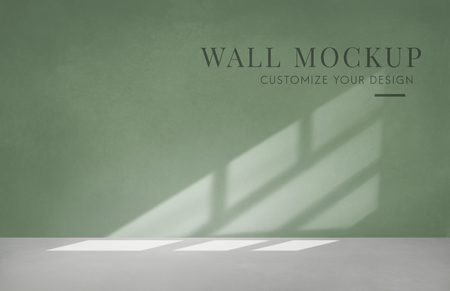 Empty room with a green wall mockup Stock Photo