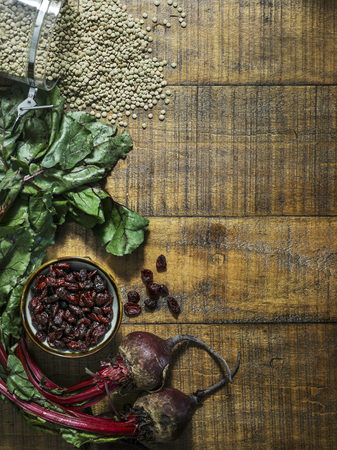 Vegan fresh cooking ingredients on a wooden table Stock Photo