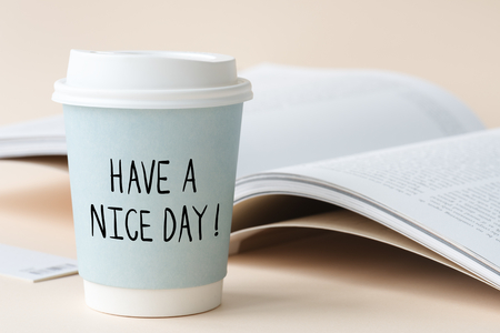Have a nice day phrase written on a paper cup Banque d'images - 116609698