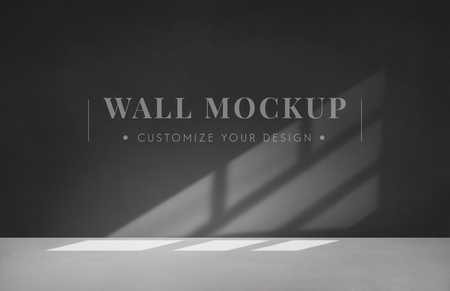 Empty room with a dark gray wall mockup 写真素材