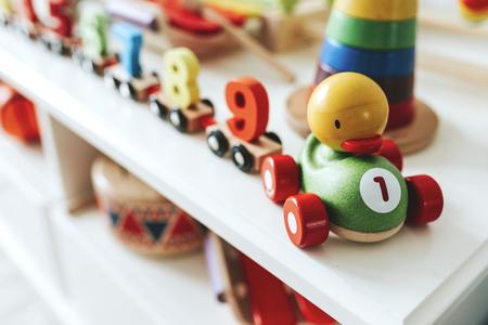 Set of kid toys on a white shelf