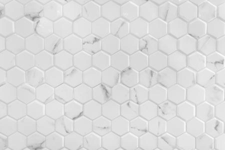 Pared de mármol blanco con patrón hexagonal