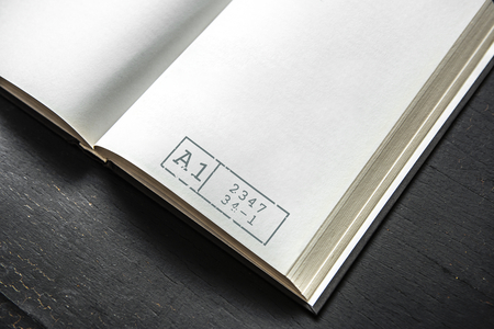 Open book mockup on a table