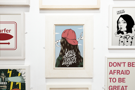 Collection of inspirational artwork on a wall
