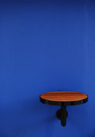 Round wooden table attached to a wall Stok Fotoğraf