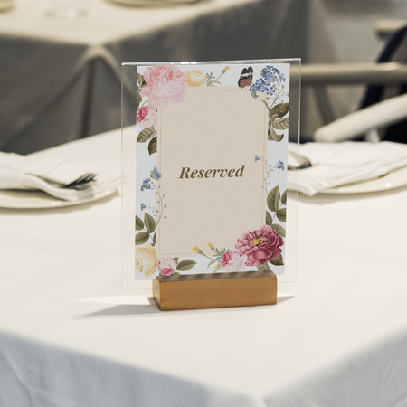 Reserved framed card mockup on the table 写真素材