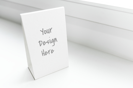 White standing sign mockup in a window