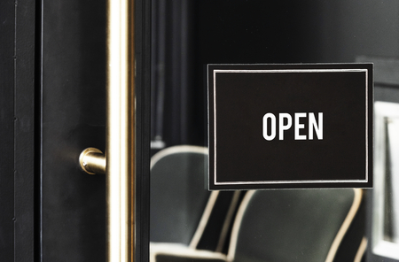 Open sign mockup on the door of a cafe