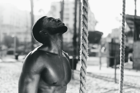 Fit man working out with ropes