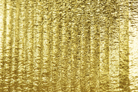 Shiny gold textured paper background