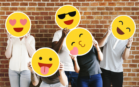 People holding positive emoticons Stock Photo - 116615736