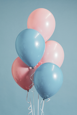 Pastel pink and blue balloons