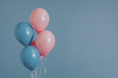 Pastel pink and blue balloons 스톡 콘텐츠